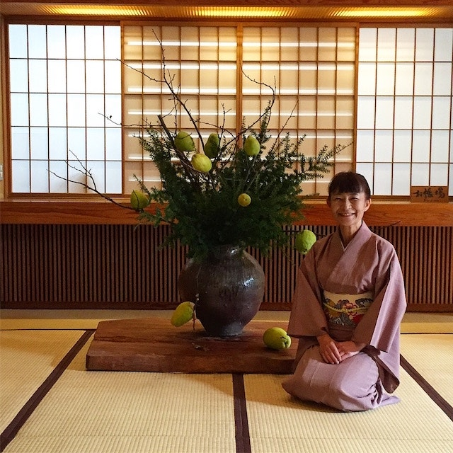 A hostess greets guests at Kayotei Ryokan