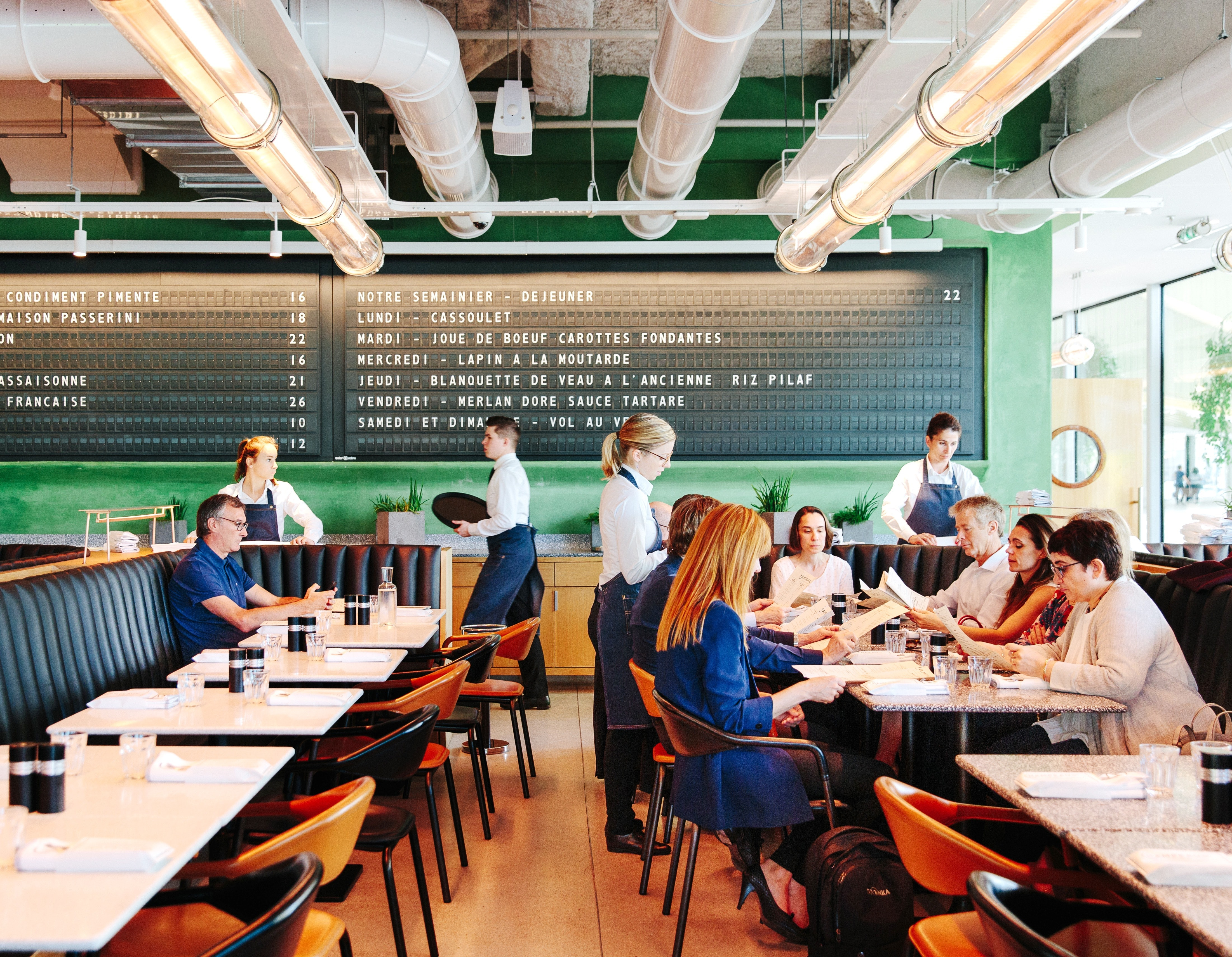 Diners eat at Alain Ducasse's brasserie, Champeaux