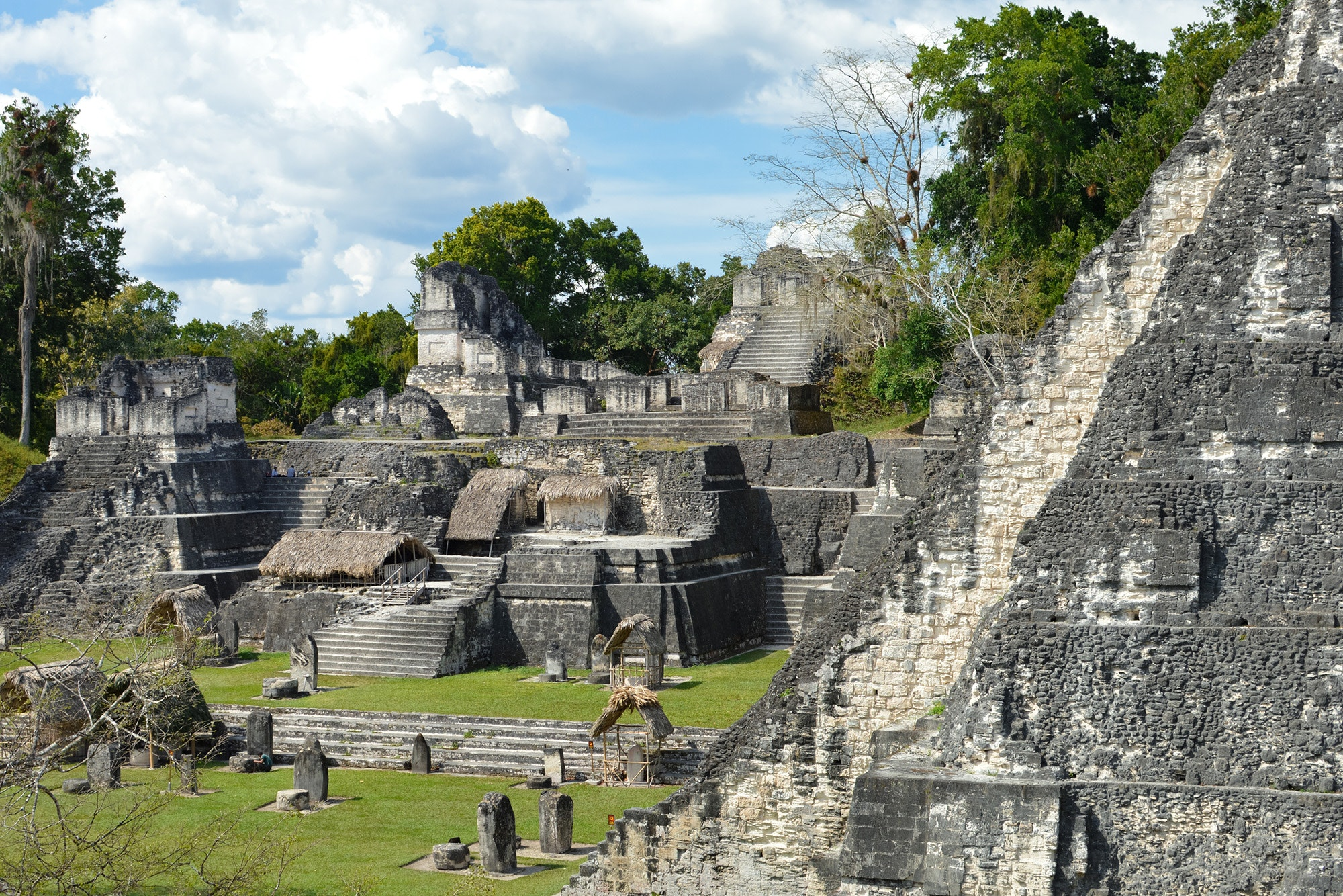 The structures of Tikal, such as the North Acropolis, are open to the public, allowing visitors to climb stairs and walk through rooms, imagining what life might have been like in 800 C.E.