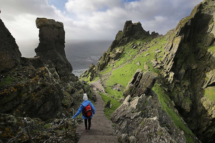Skellig Michael is the larger of two rocky islands located eight miles off the coast of Ireland and accessible by boat.