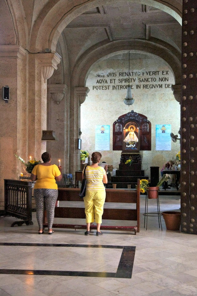 As the church named after Cuba's patron saint, Caridad del Cobre is always busy with the faithful stopping by to say prayers.