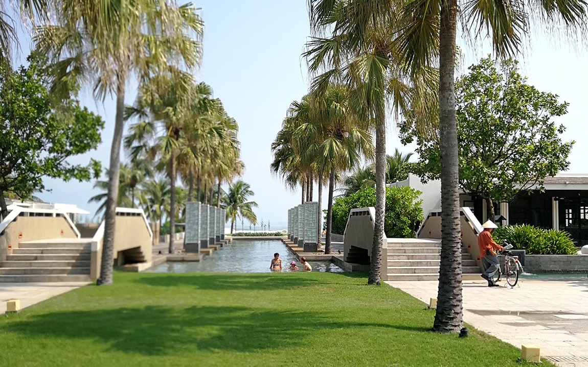 The beachfront Hyatt Regency Danang offers a central location for touring town and offers spacious suites.