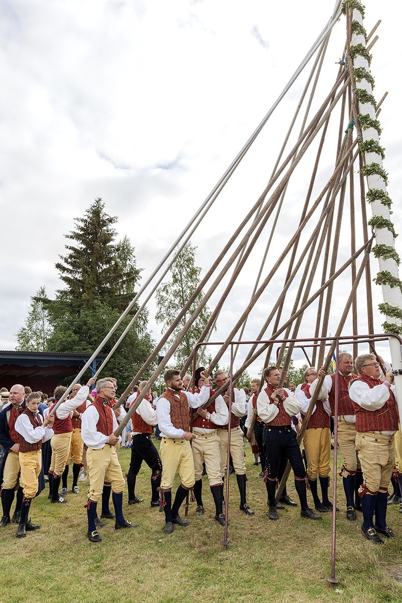Midsommar maypoles, covered in greenery and flowers, go up all over Sweden. The cross-shaped pole of Swedish tradition is unlike England's May Day pole