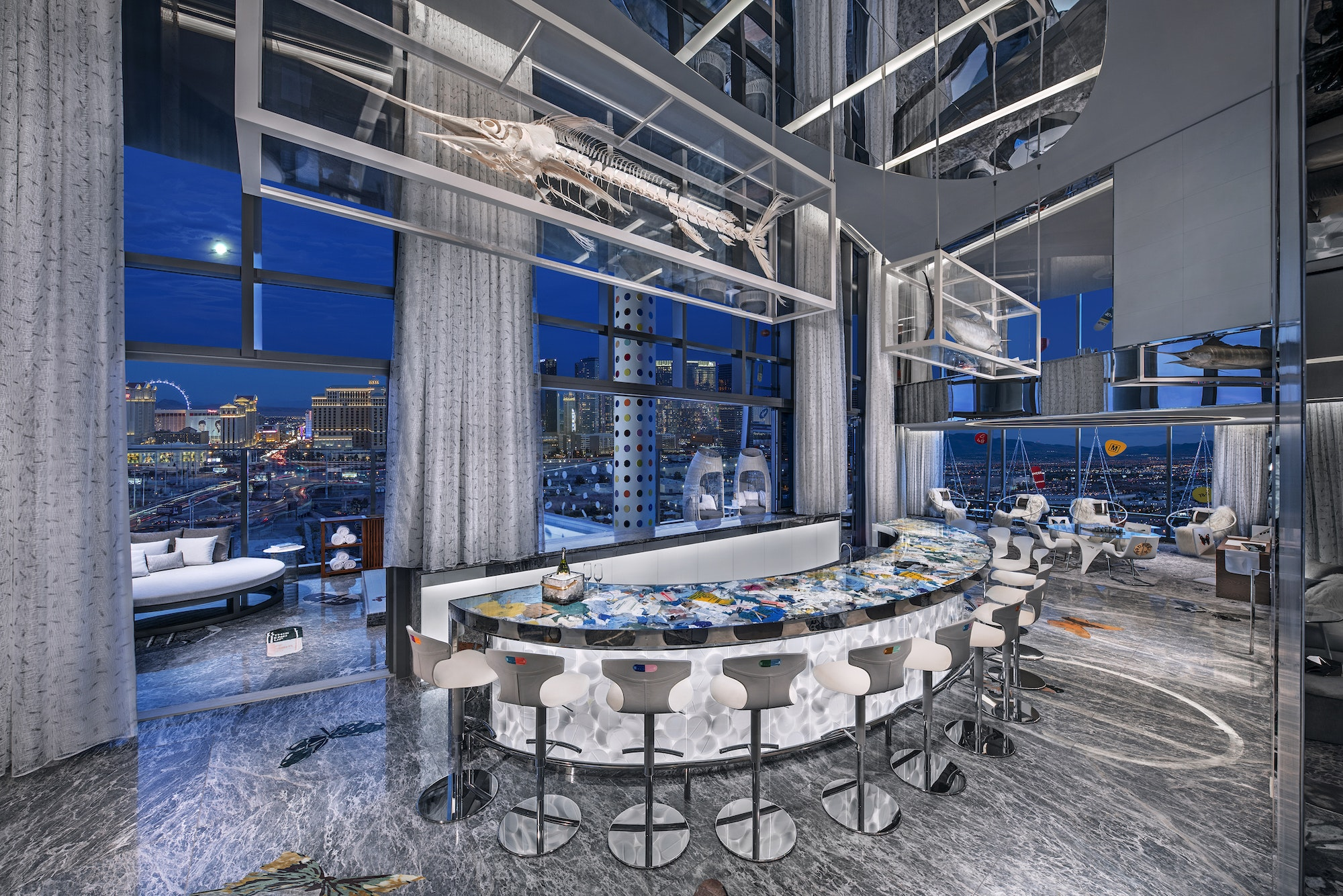 The bar—topped with a sea of medical waste—overlooks the cantilevered pool.