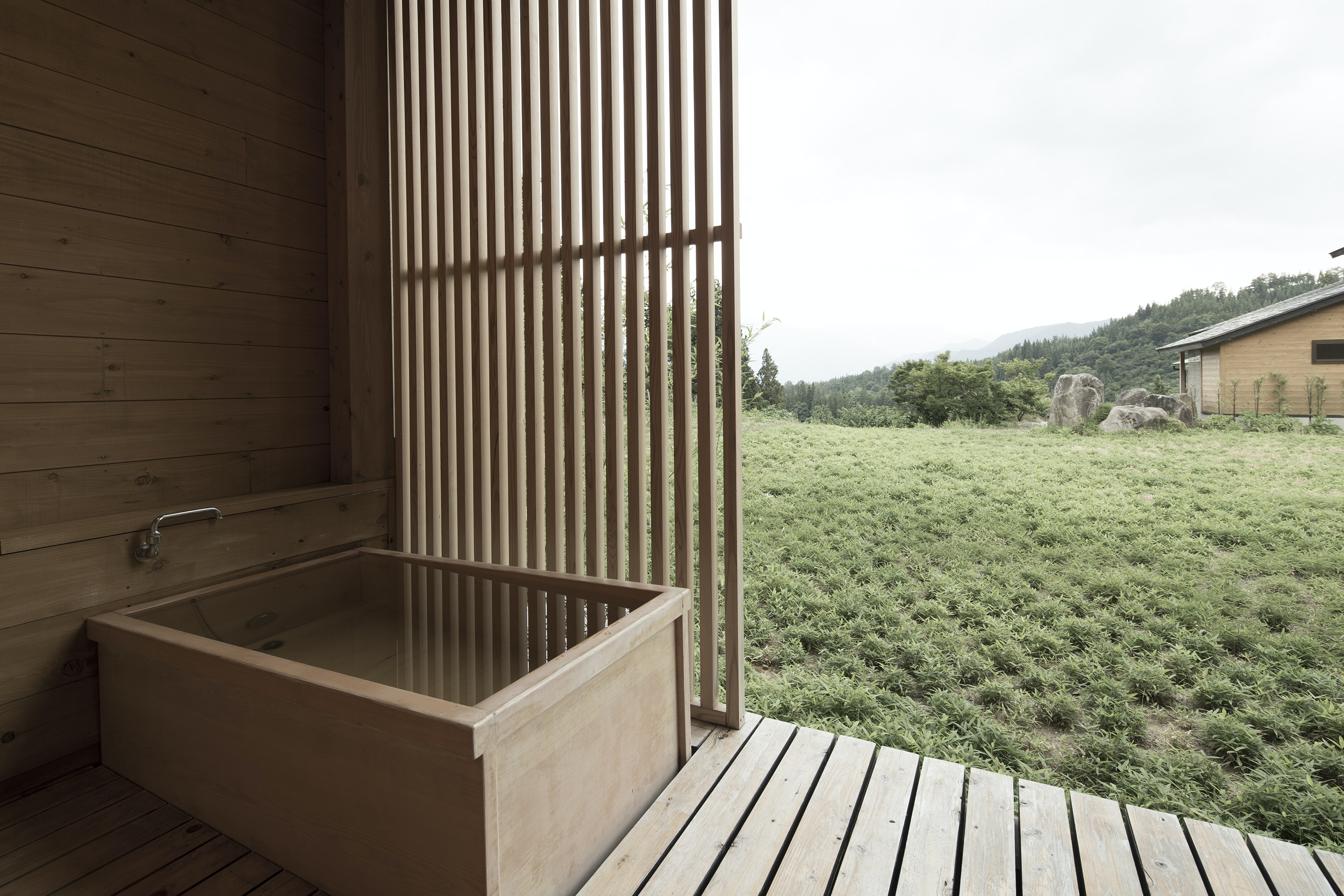 Relax in design-forward serenity in the soaking tubs at Satoyama Jujo.