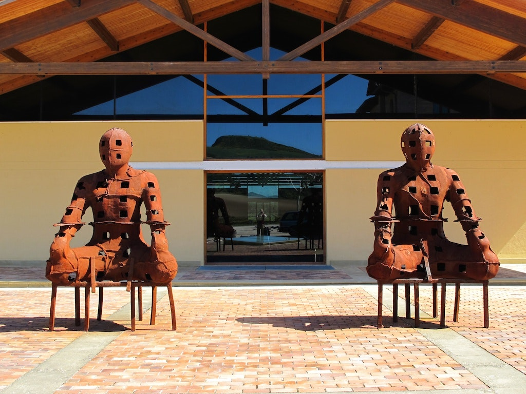 """""""The Guardians"""" by Xavier Mascaró sit as sentries to one of the property's buildings."""
