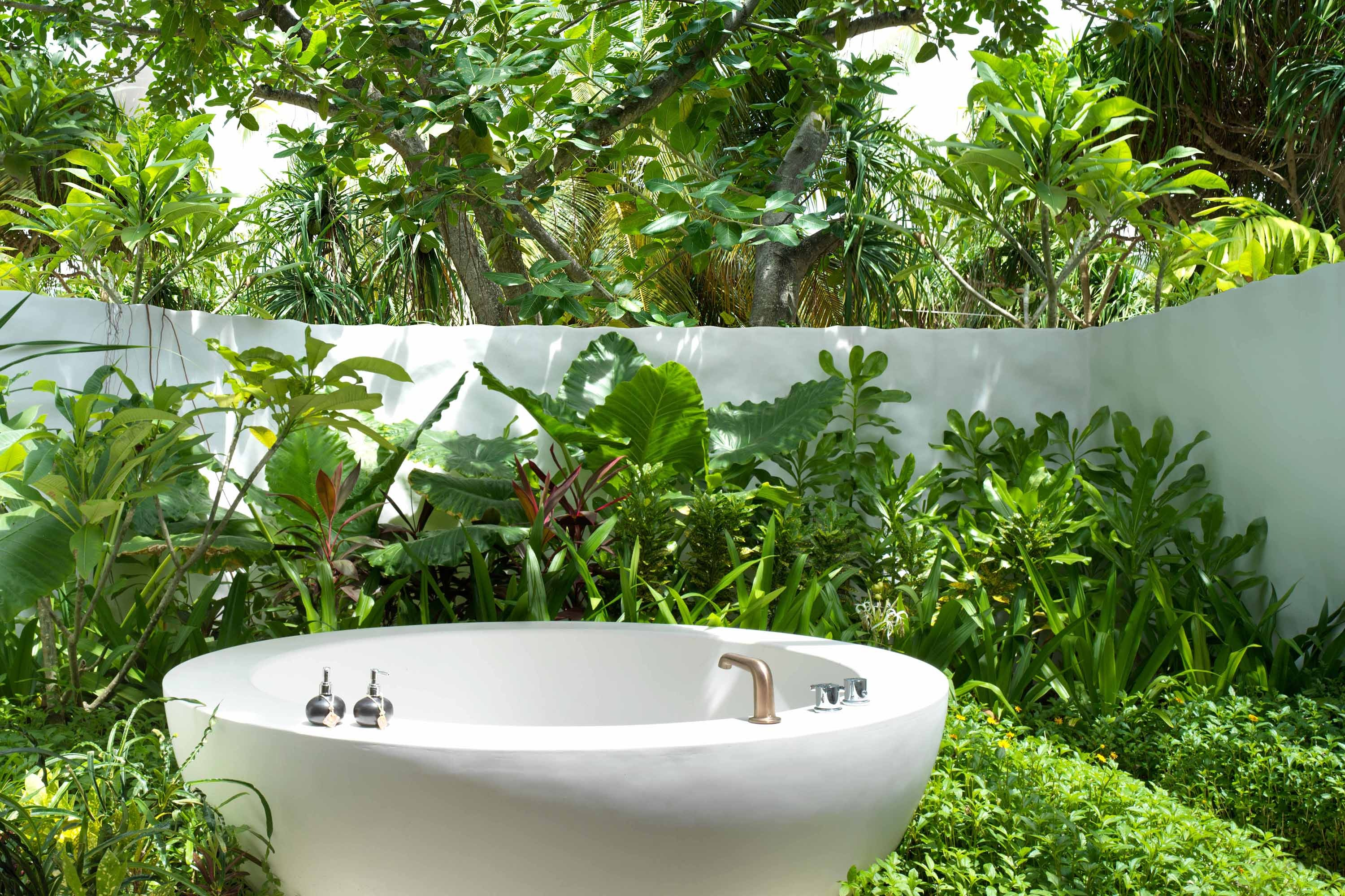 Birdsong serenades guests in the tropical tubs at the Fairmont Maldives.