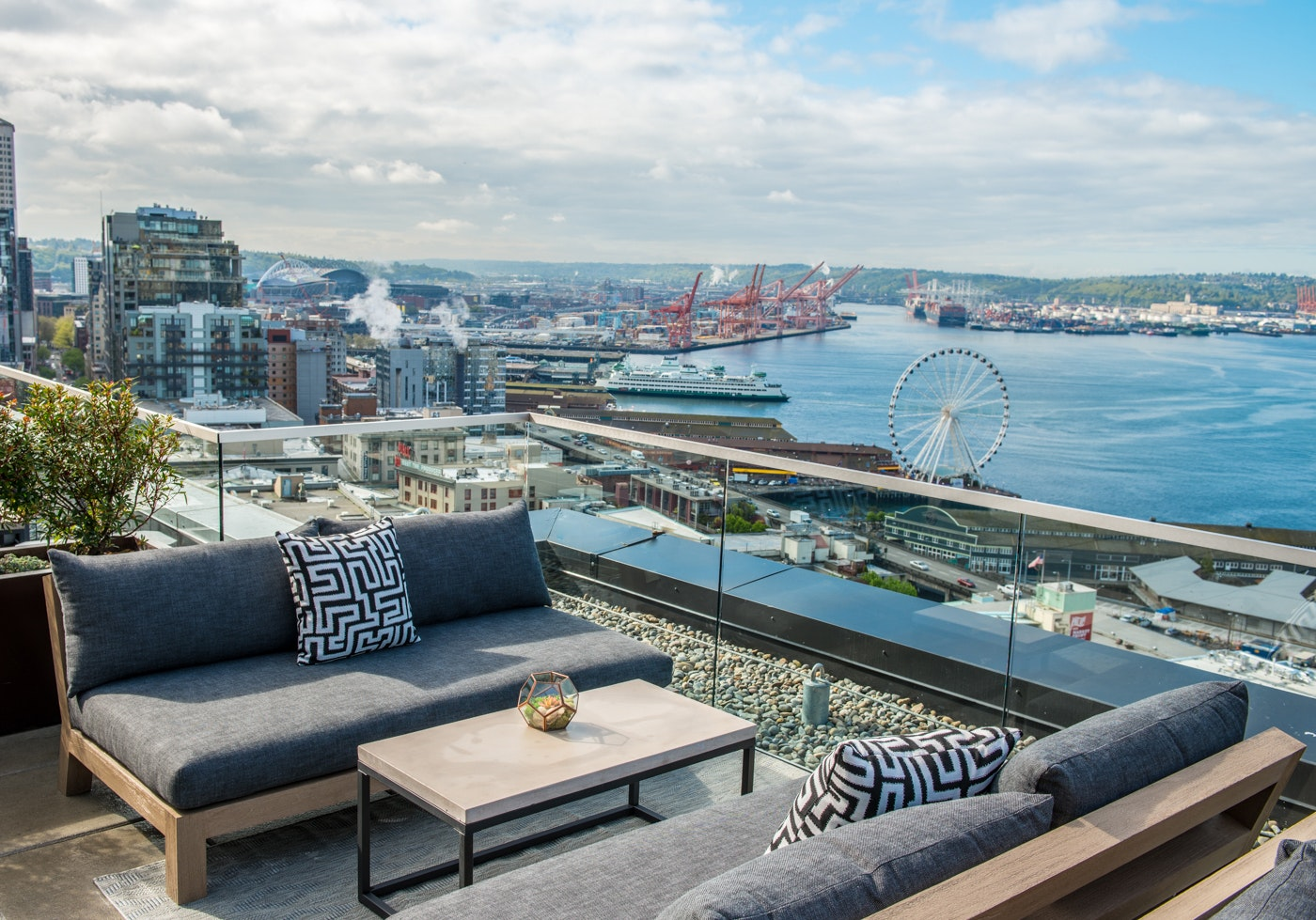 Thompson Seattle's 12th-floor rooftop bar and terrace grants views out over Elliott Bay and the snowcapped Olympic Mountains.