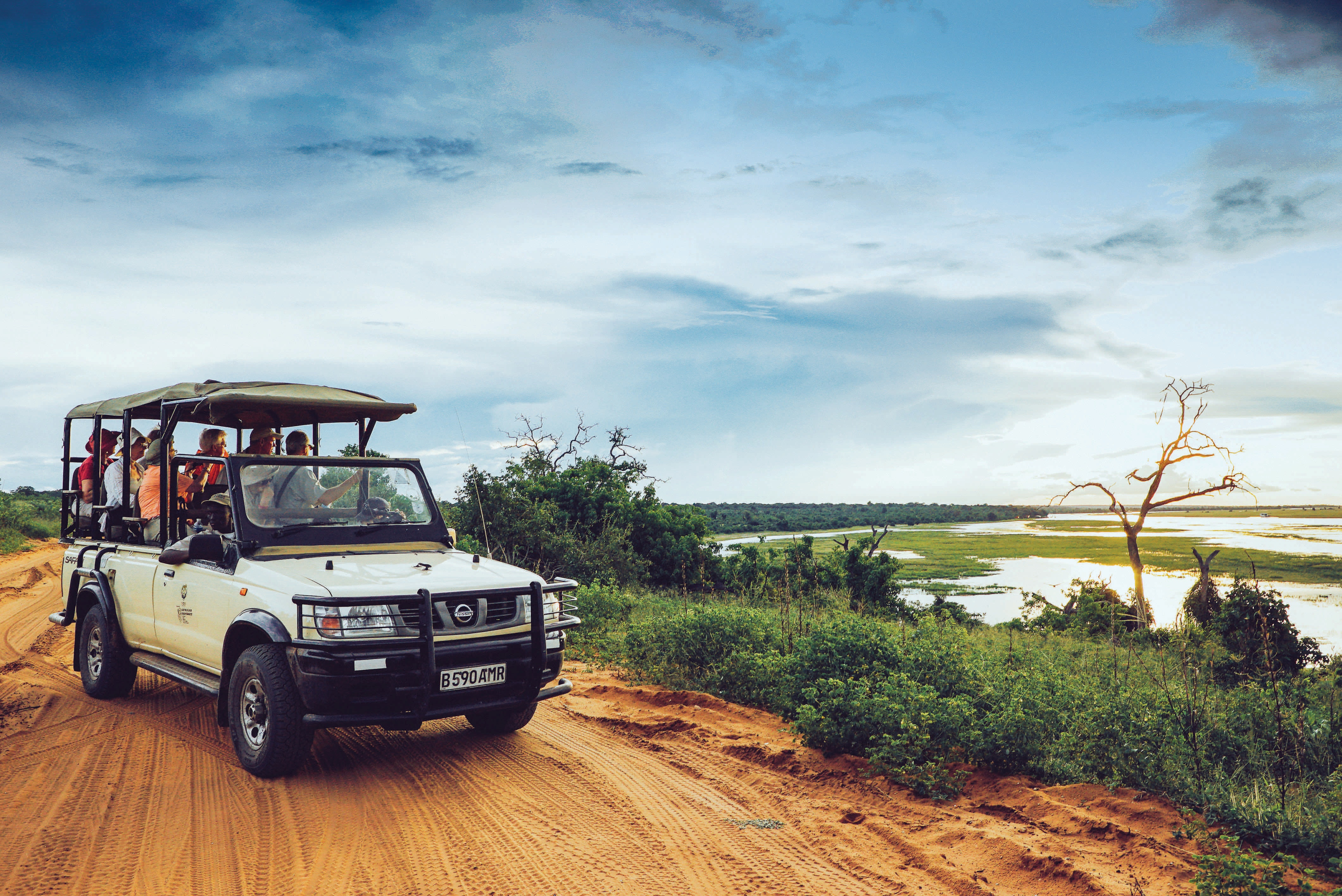Explorations guests searching for wildlife during a game drive at South Africa
