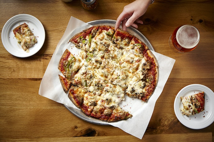 Labriola, on the Magnificent Mile, caters to all tastes with thin crust, deep dish, and artisan-style pizza pies on the menu.