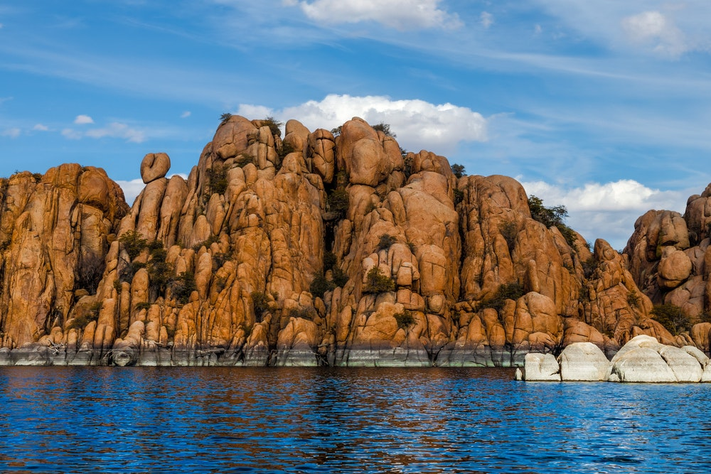 The rock formations of Granite Dells tower over Watson Lake in Prescott, AZ.