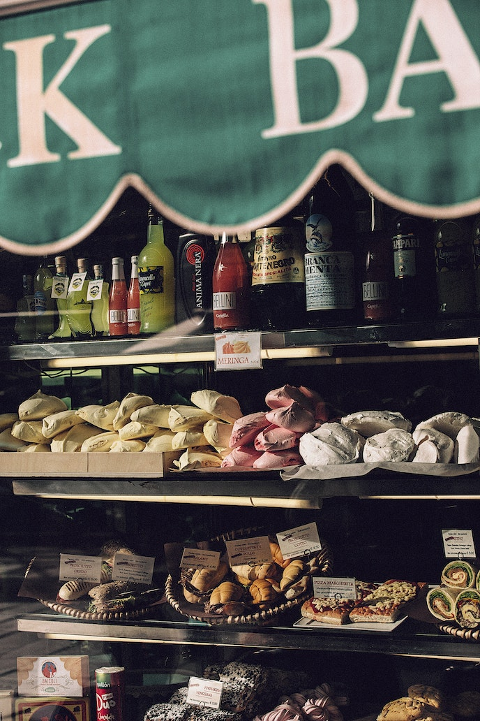 Supermarket chains threaten the sustainability of traditional Italian markets by selling prepackaged panini to tourists and changing residents' shopping habits.