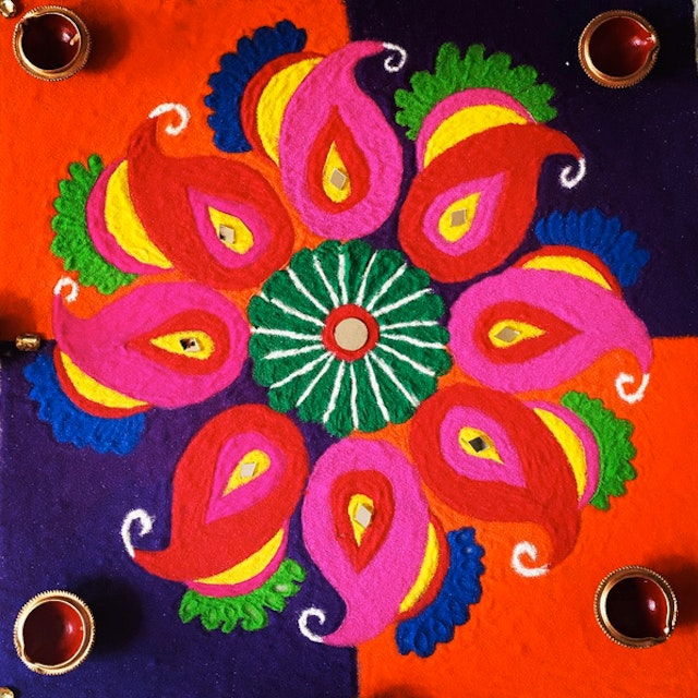 Rangoli designs, made of colored rice, sand or flower petals are another beautiful way of celebrating Diwali.