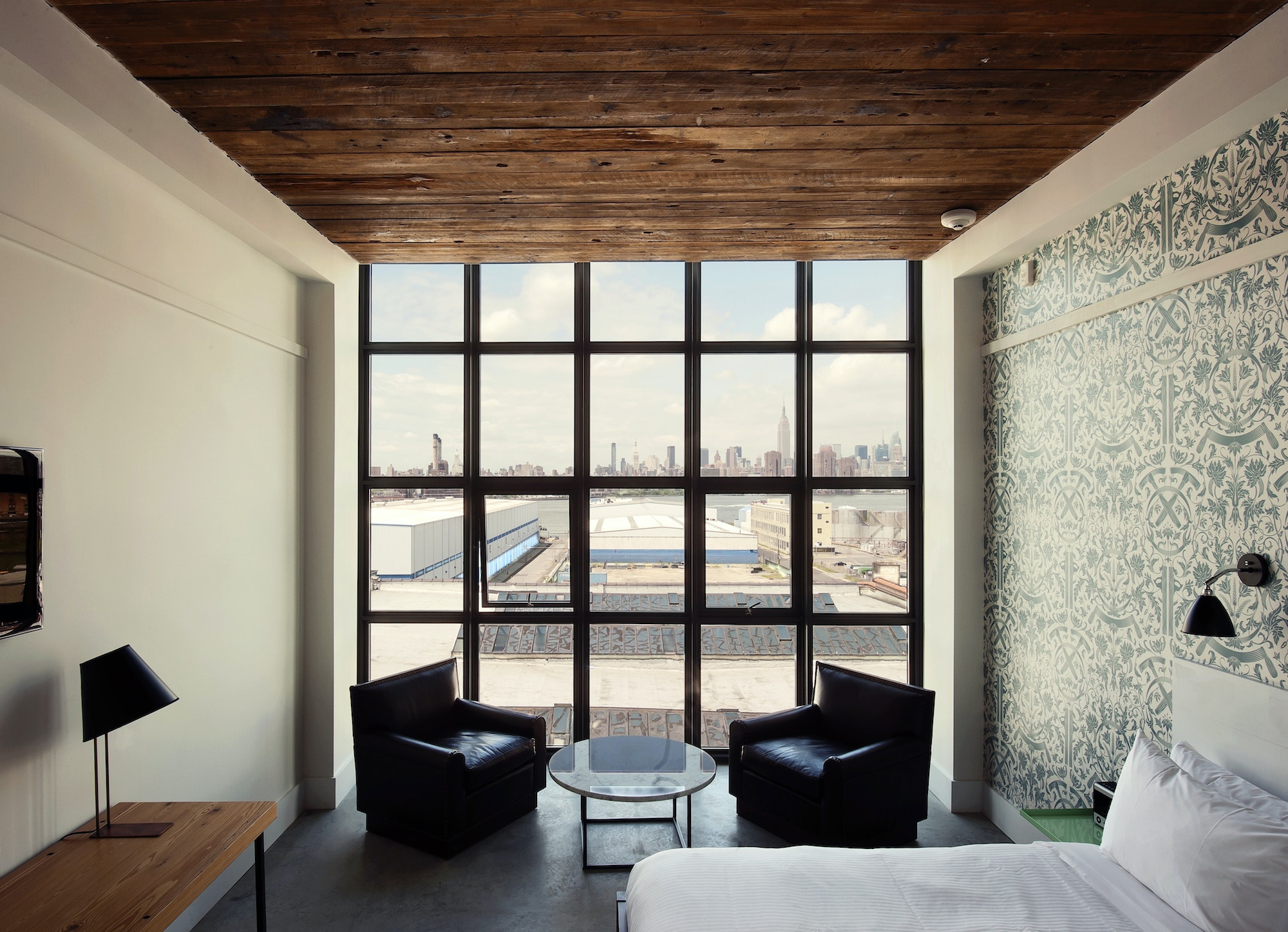 Brooklyn's waterfront Wythe Hotel combines reclaimed materials with modern interior design.