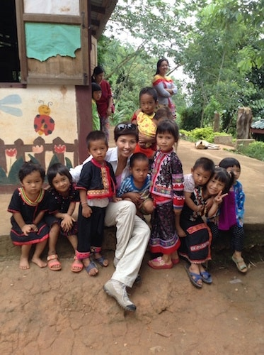 Rainy Chan with hilltribe children on a recent trip to northern Thailand