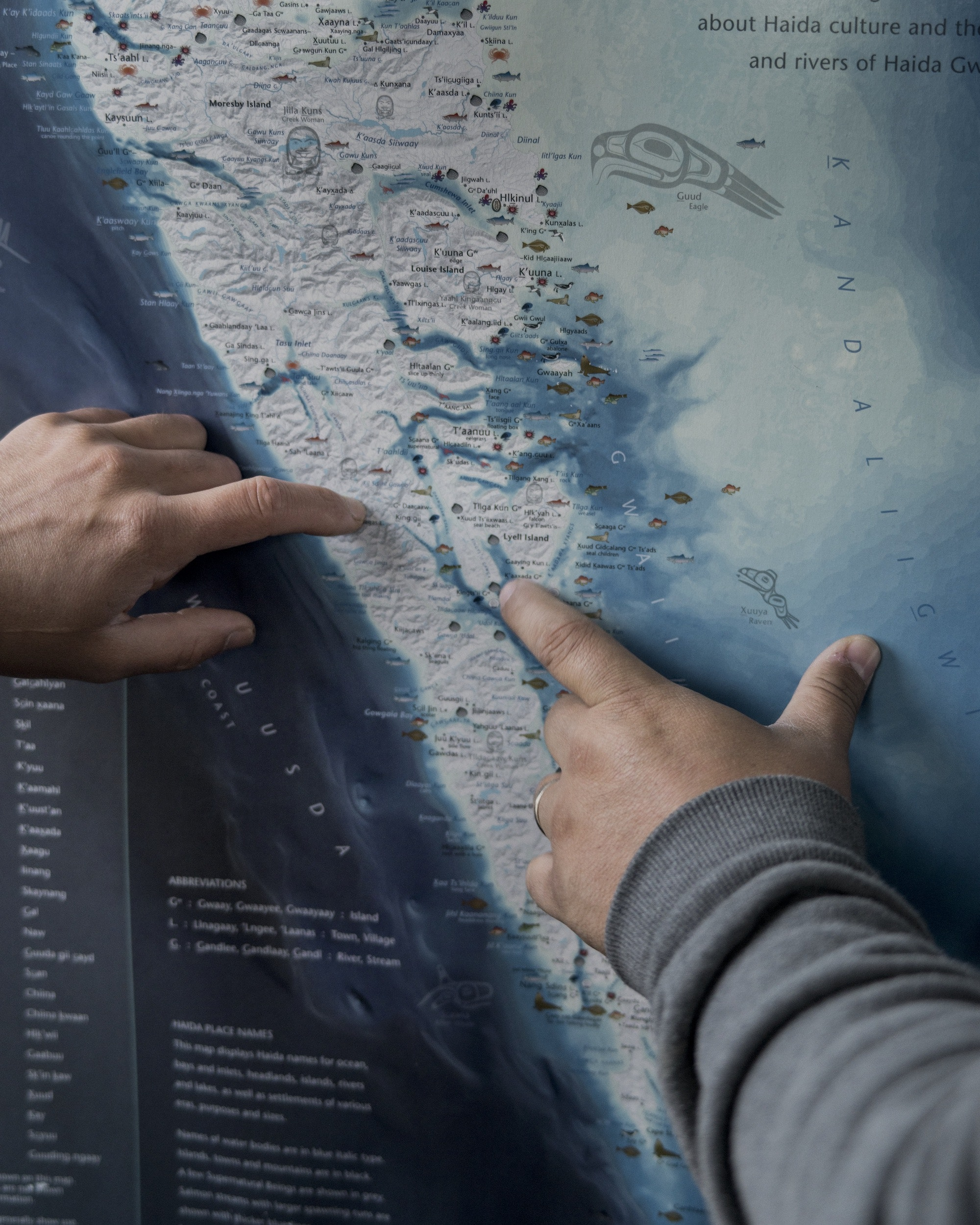 Iiljuwaas Leonard Arens points out fishing spots on his expedition boat's map.