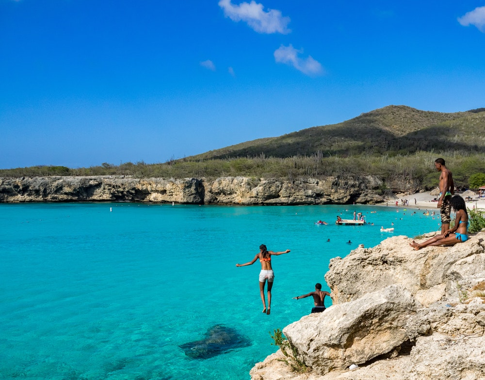 Cooling down in the clear blue waters of Knip Beach in Curaçao