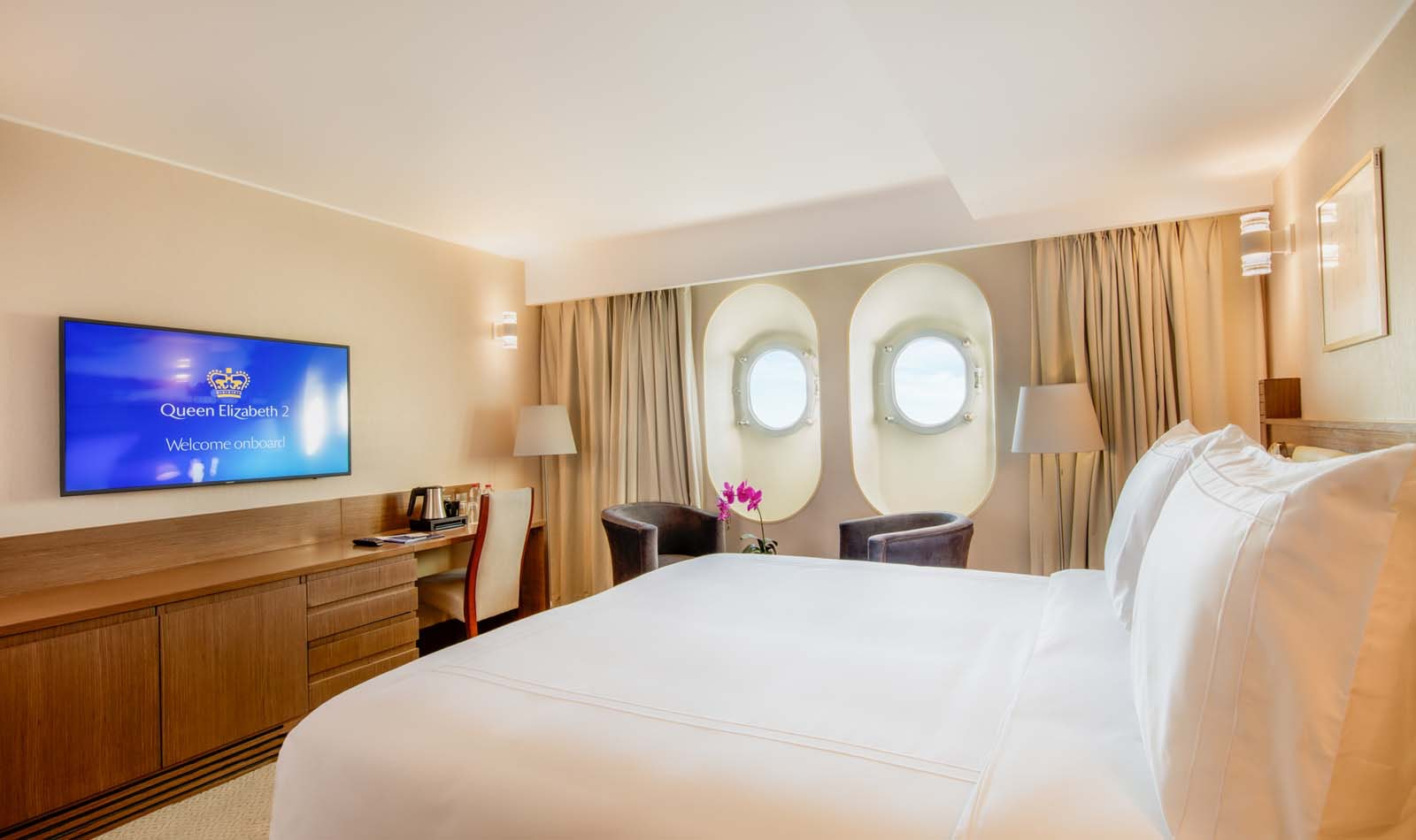 The QE2's staterooms are bright and modern, but retain some classic nautical features.