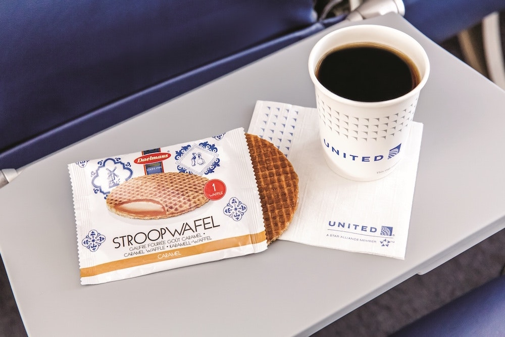 Illy coffee and an accompanying stroopwafel on United