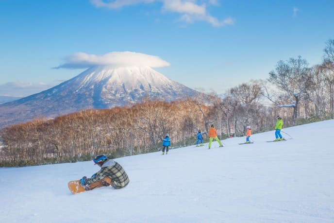 Learn to ski on the slopes in Hokkaido, many of which overlook Mt. Yotei.
