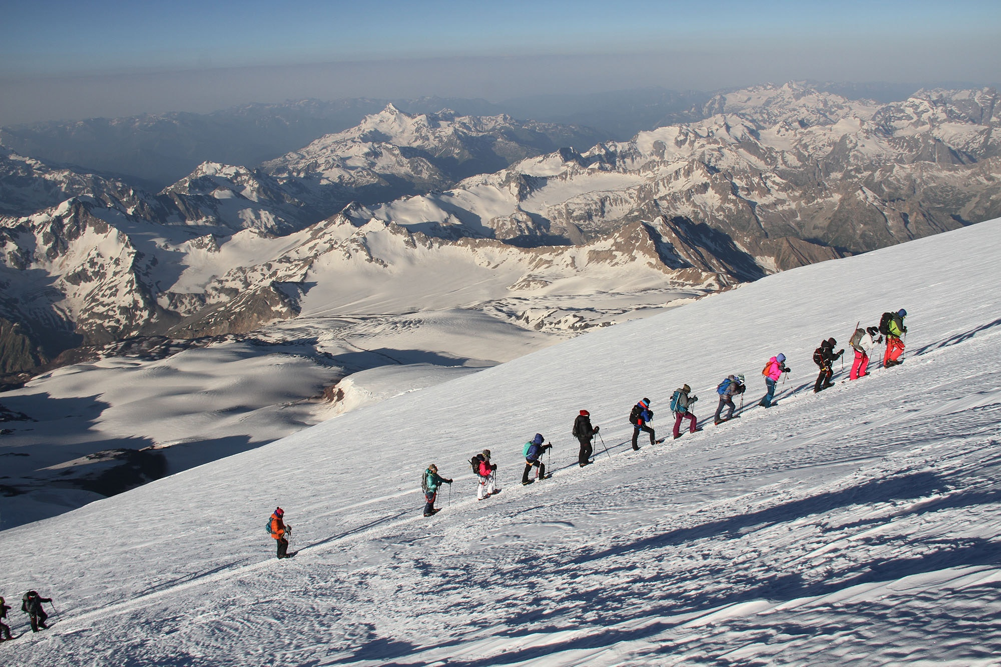 The WHOA group of women—armed with trekking poles, ice axes, harnesses, and crampons—climbed Russia's Mount Elbrus.