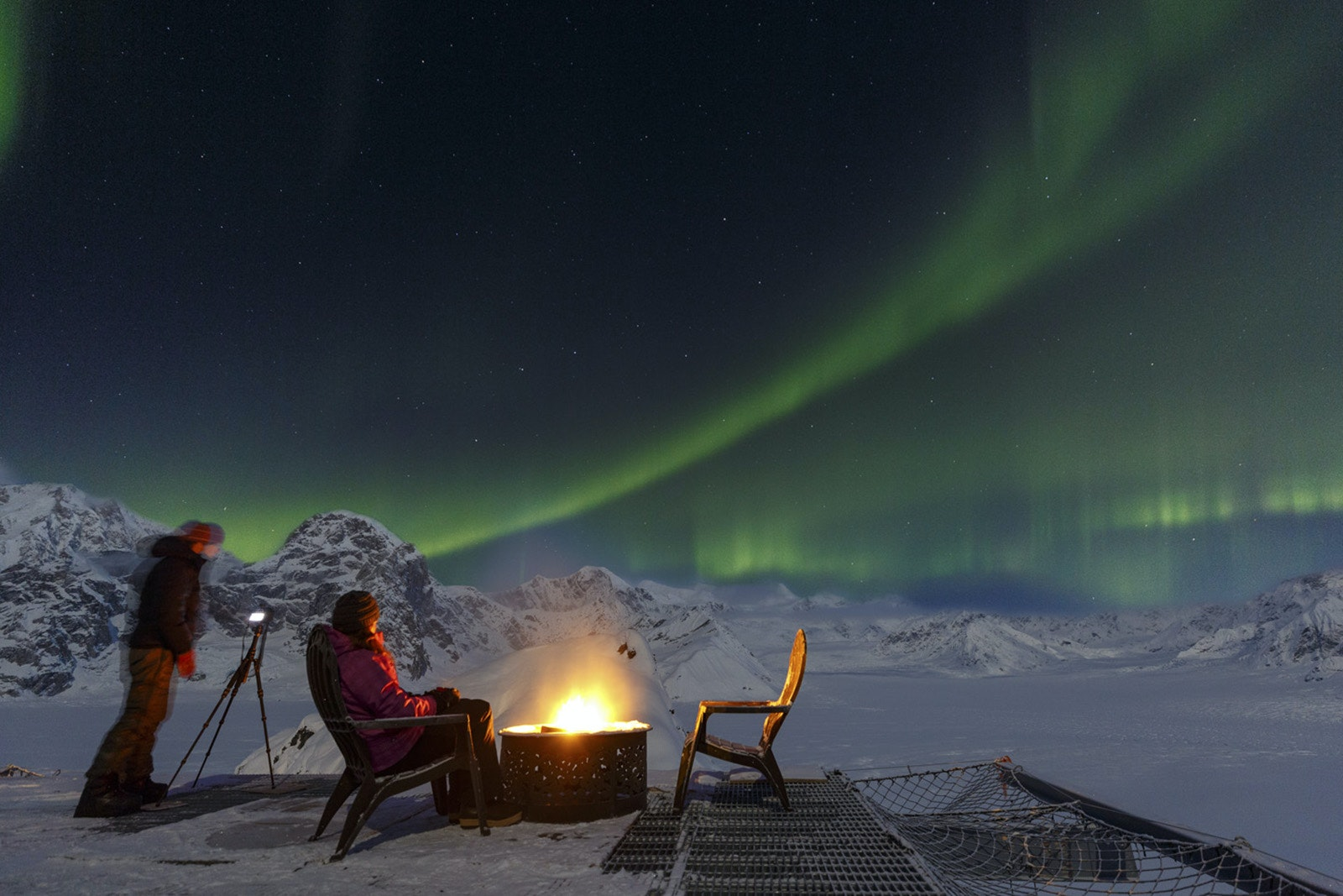 While the snowy landscape may not change much over the seasons, winter's dark nights make for perfect aurora borealis watching from the helipad.