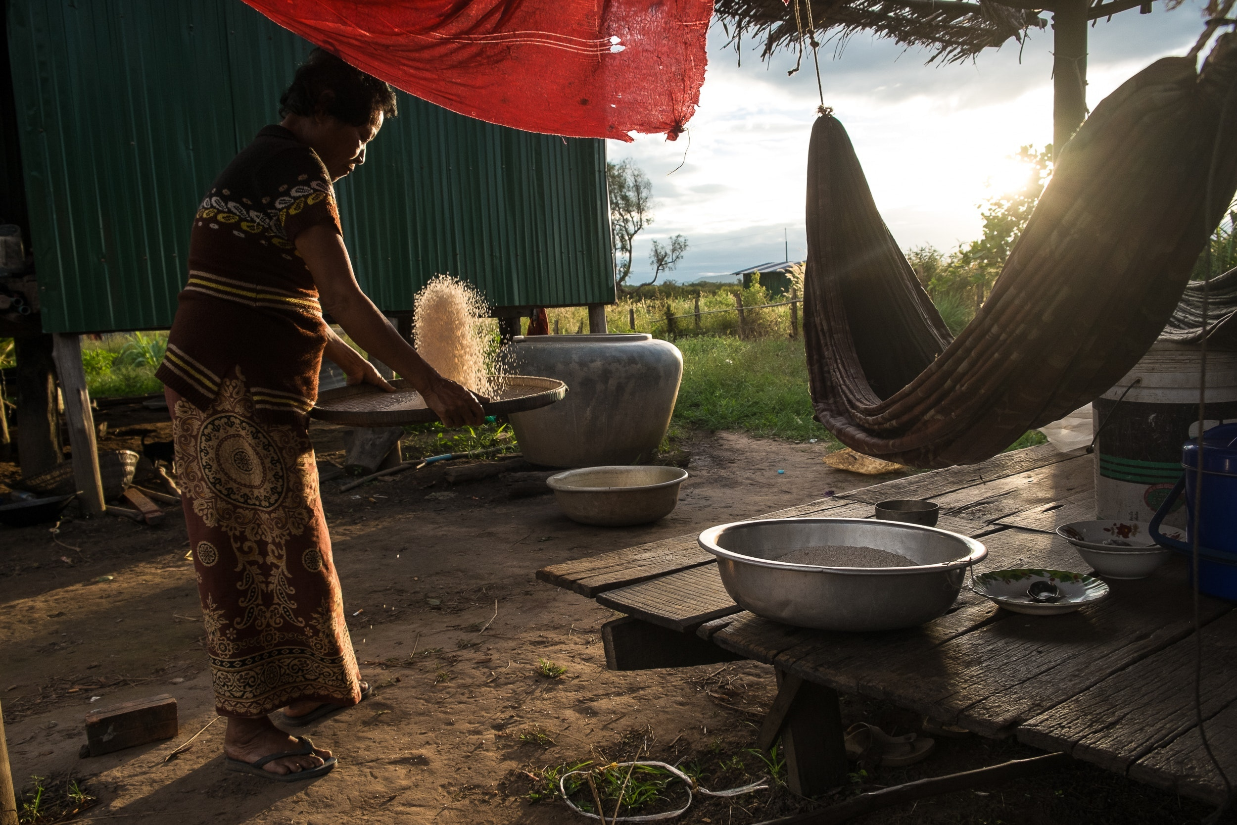 Drying rice in the village of Chi Phat