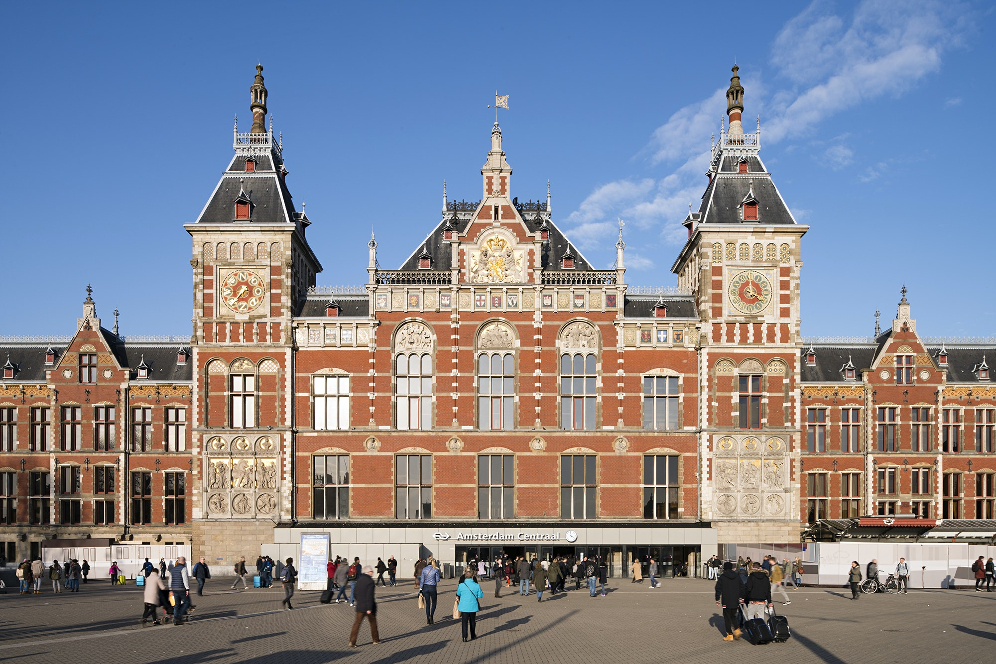 The red-brick Amsterdam Centraal Station looks more like a palace than a train station.