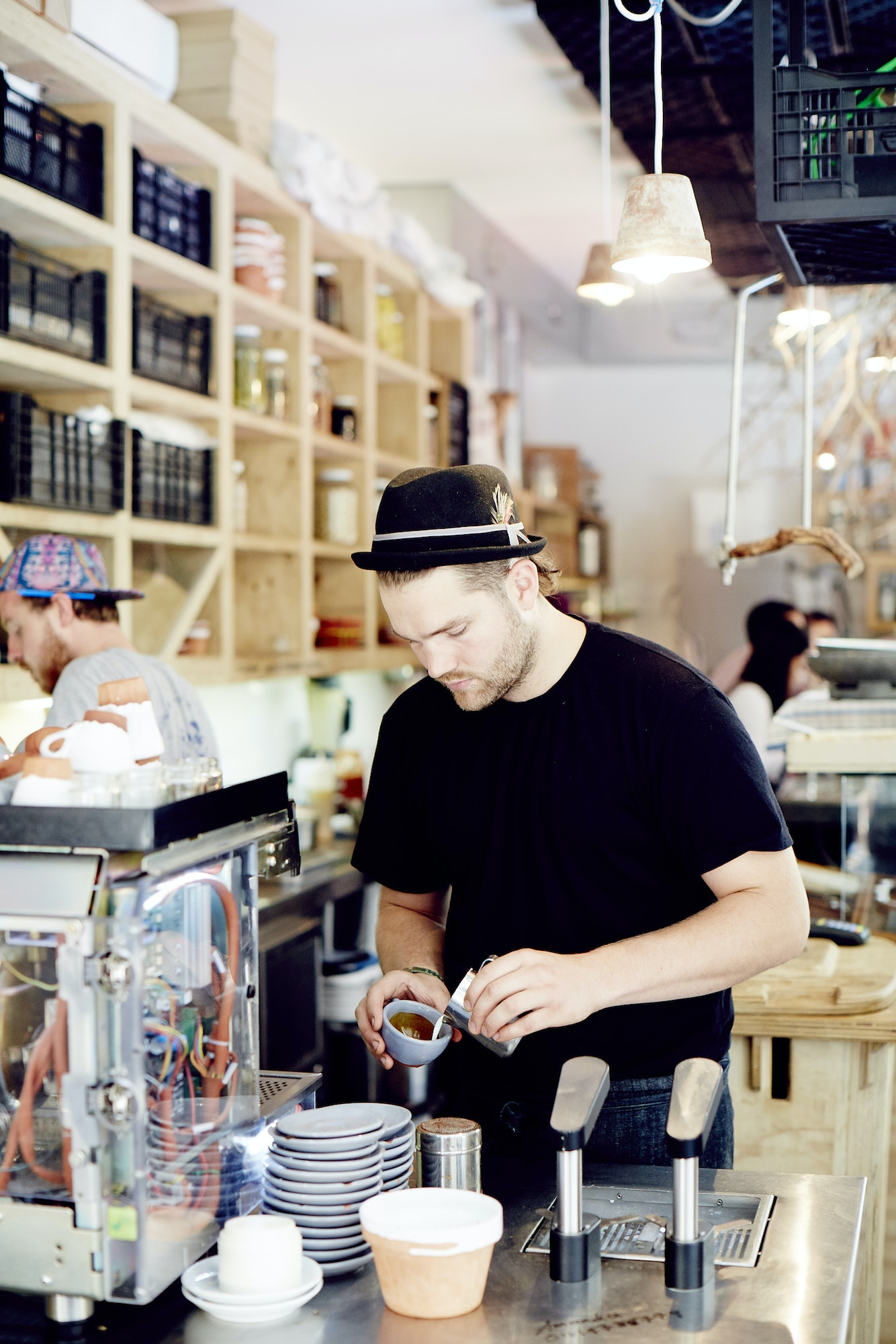 A barista makes a flat white at Silo by Joost.