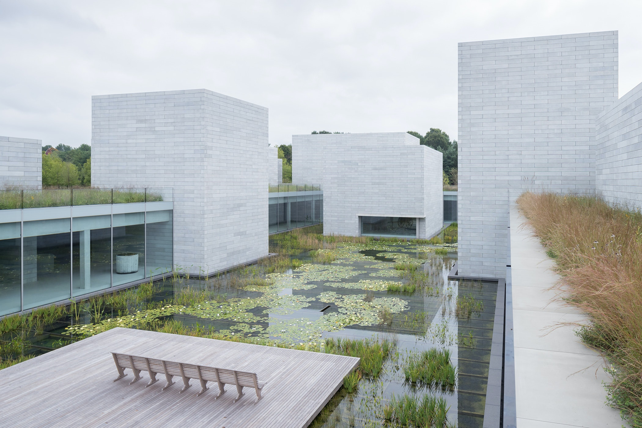 The Water Court's glass walls frame the surrounding landscape.