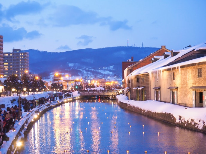 Illuminated snow sculptures draw visitors to Otaru for the annual Snow Light Path Festival.