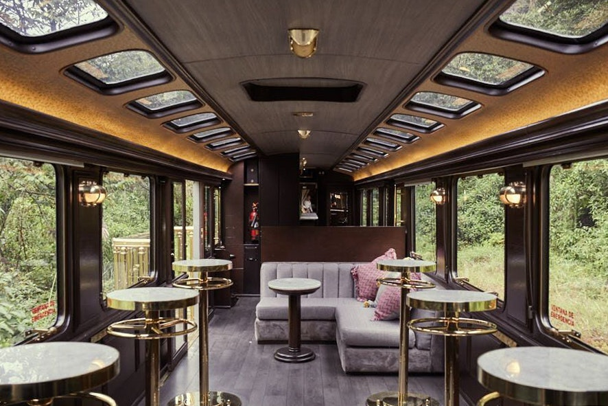 On the First-Class Machu Picchu Train, passengers are greeted with a cocktail.