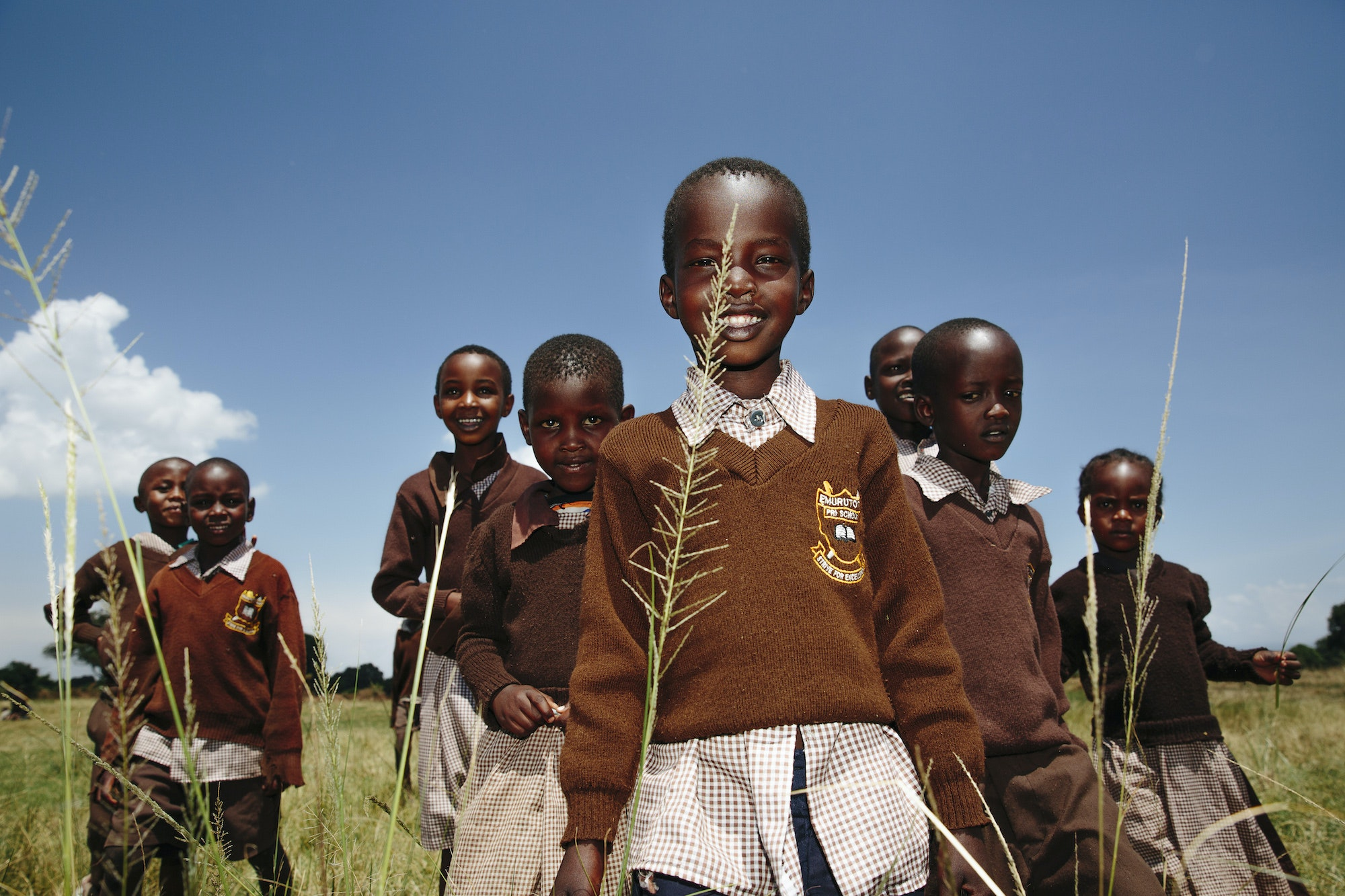 Children from a local school supported by Angama's foundation pose for a photo.