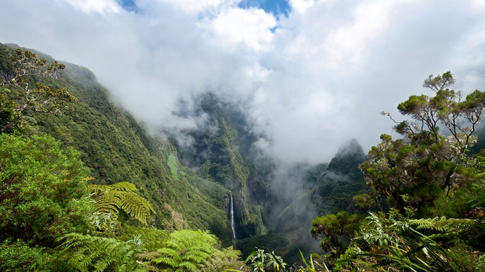The interior of Réunion, protected by a ring of ridges, hides great hiking trails and stunning waterfalls.