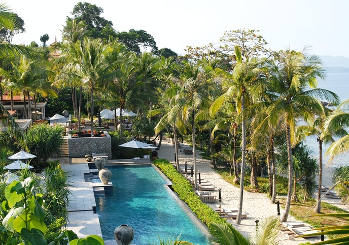 Luxuriate on Phuket at the all-villa Trisara resort, with extras like a private beach, spa, and Michelin-starred eatery.