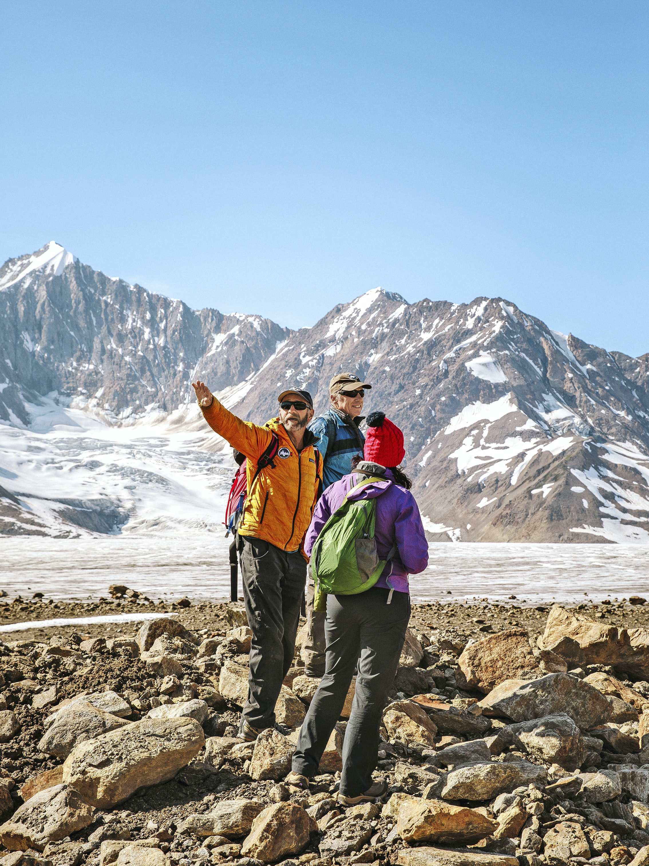 Standing amid the rocky debris of a glacial moraine, guides and hikers from Ultima Thule Lodge take in one of the panoramas of Wrangell–St. Elias National Park.