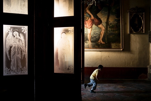 A boy plays around in the Cathedral of Our Lady of the Assumption, which was originally constructed in 1535.