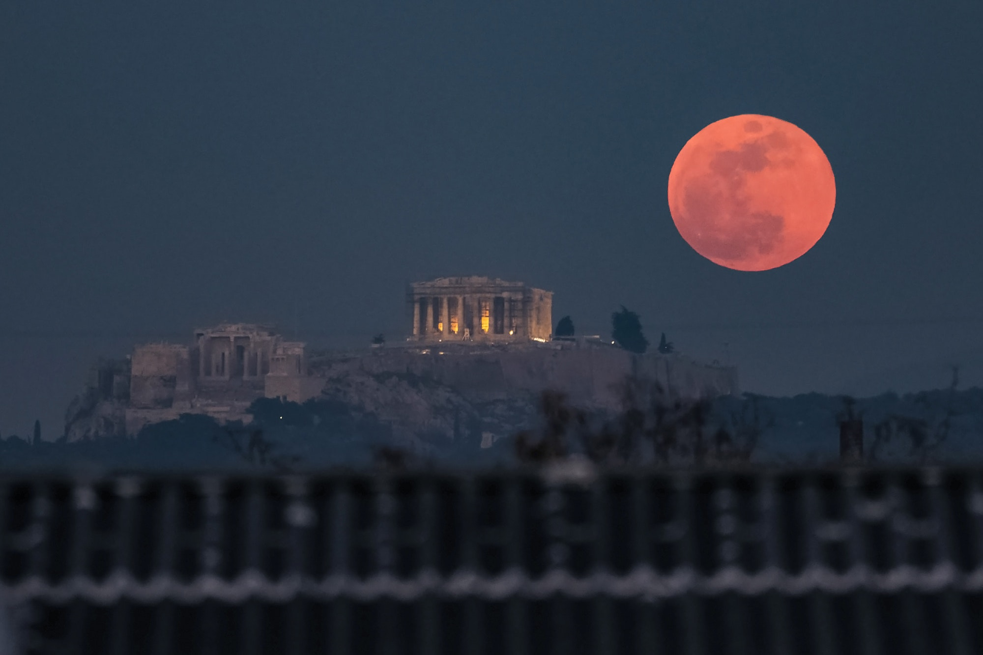 A super blood moon rises behind the Parthenon in Athens on January 31, 2018.