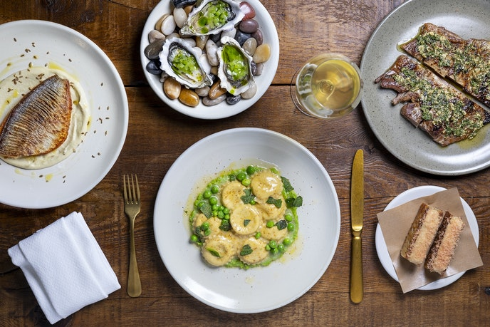 Alameda Supper Club's menu includes dishes like ricotta ravioli with English peas and oysters with chive oil.