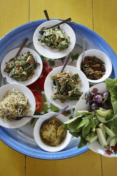 Locals at Nam Pan market near Inle Lake typically lunch on snack-size salads such as fermented tea leaf and pickled ginger.
