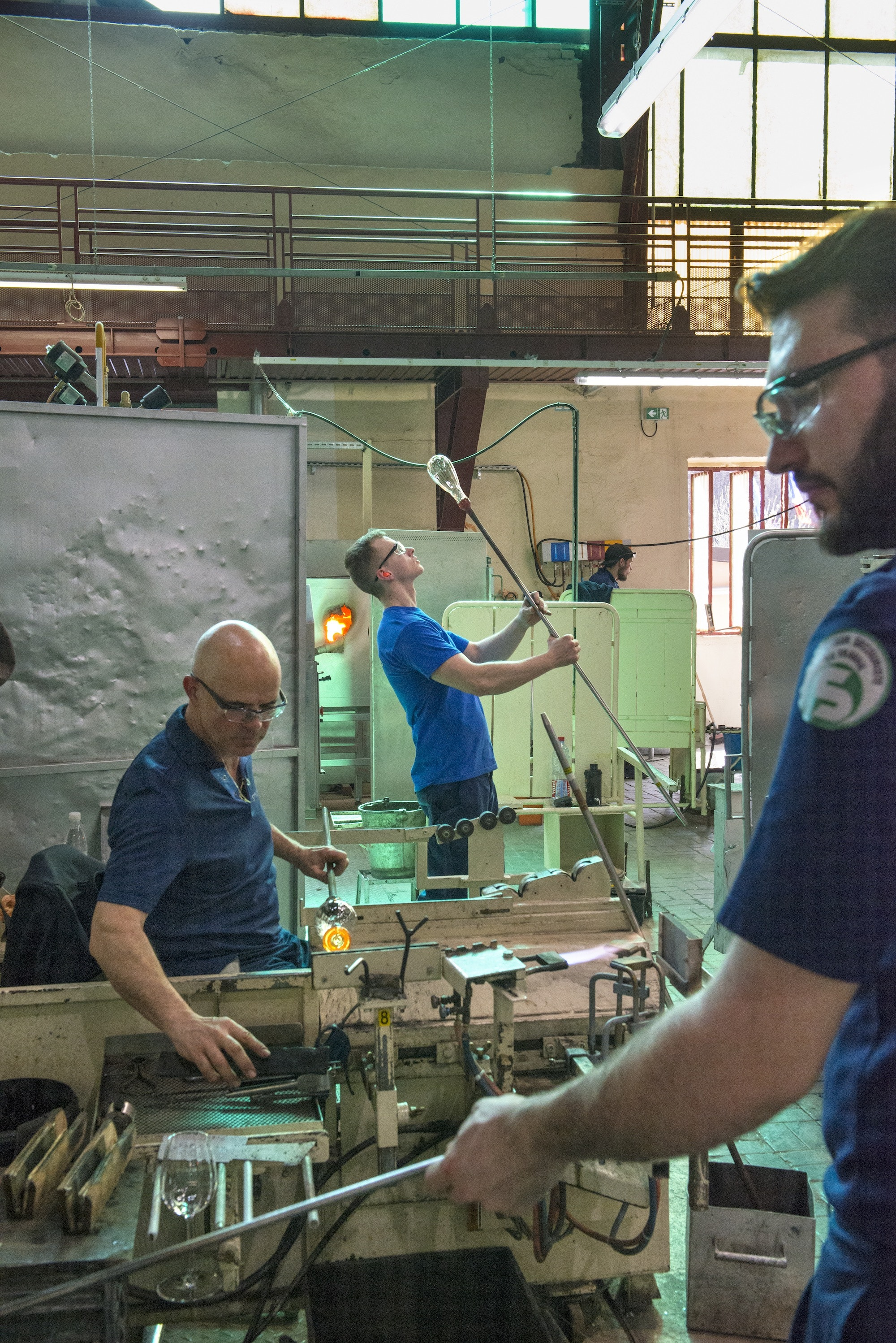 Glassblowers in the hot workshop.