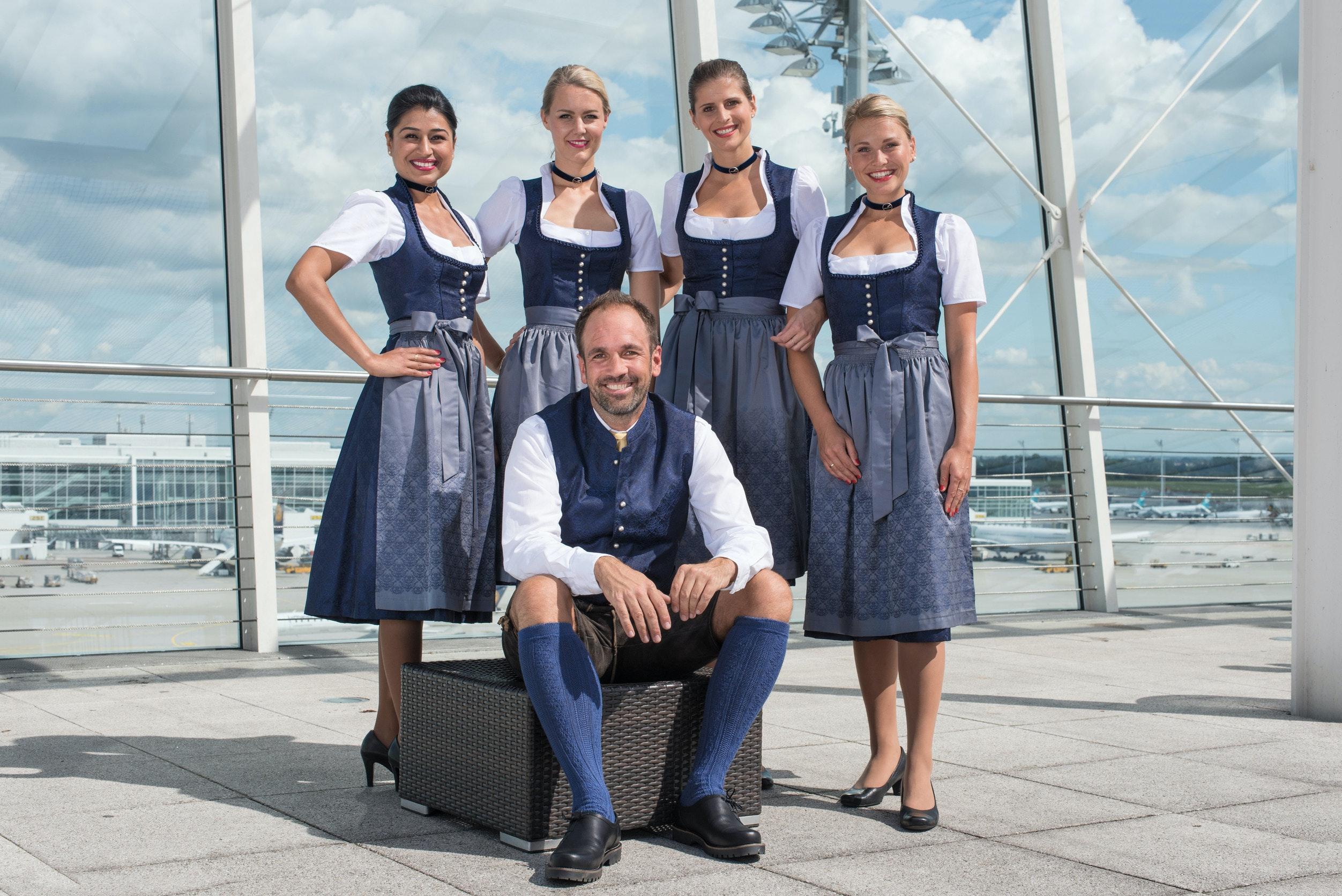Munich's traditional clothing specialist, Angermaier, designed the custom dirndls and lederhosen for the flight attendants.
