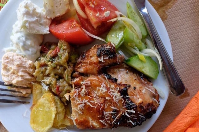 A grilled chicken dish from The Famous Rooster