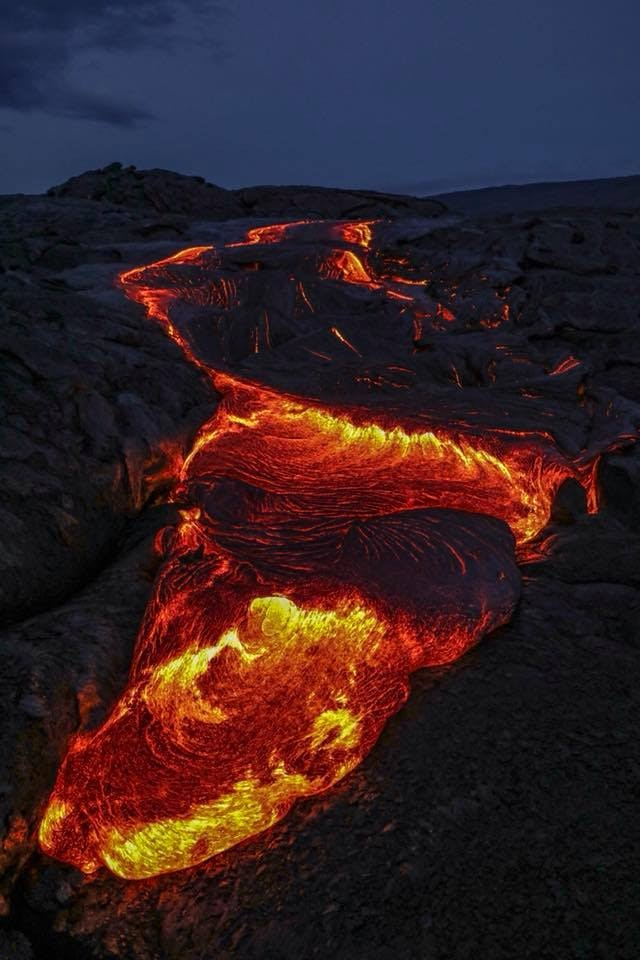 The vibrant, orange rivers of lava are easiest to locate in the dark.