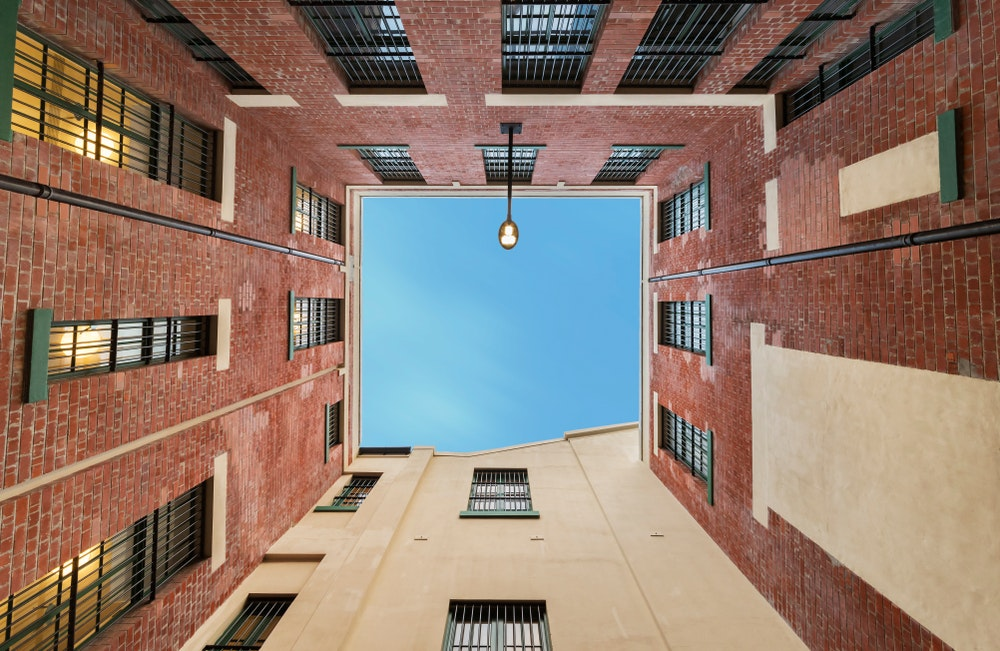 Looking up from inside Tai Kwun, a renovated police station turned cultural center