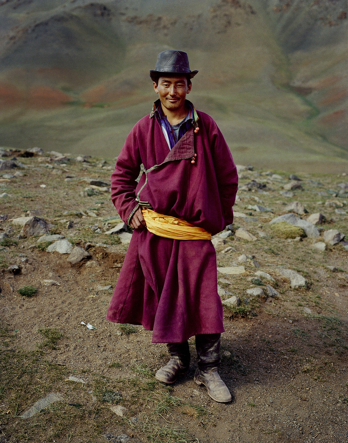 """Traditional coats known as """"deel"""" have been sported among Mongol tribes for centuries. They are commonly worn with a large silk sash."""