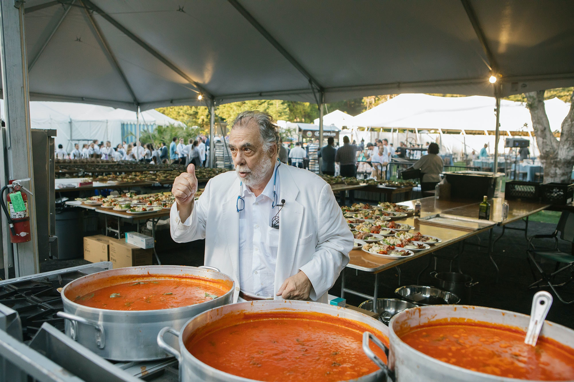 Francis Ford Coppola checks out the sauce for his hand-rolled gnocchi course.
