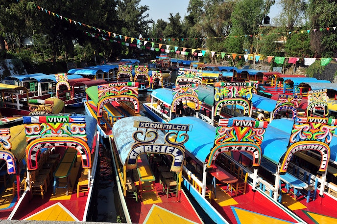Colorful gondolas await their riders in Mexico City's Xochimilco canals.