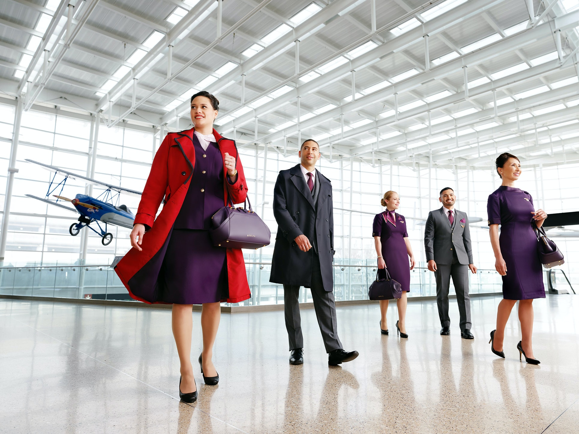 "Delta Air Lines incorporates the company's ""Passport Plum"" into its Zac Posen uniforms, as an extension of its branding."