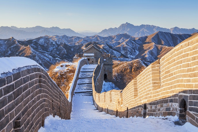 Hike through virgin snow on remote, wild, and striking sections of the Great Wall, such as at Jinshanling, a two-hour drive north of Beijing.